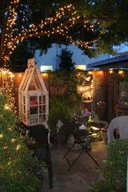 small garden lighting ideas. patio at night love the tree lights great for a cozy date or just wine time small garden lighting ideas