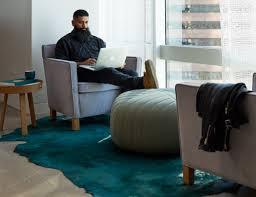 krefeld lounge chair muuto five pouf muuto around table thomas bentzen edelman kyle bunting rug refuge