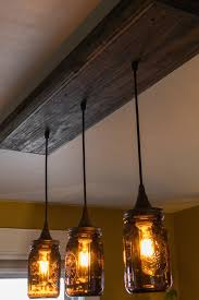 wooden light fixture with three pendant lights