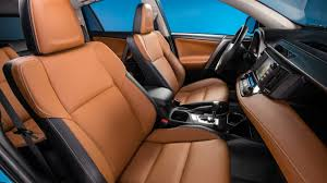 the 2018 toyota rav4 interior looks good in cinnamon entry models use fabric while upper models shown here use softex a vinyl leather subsute