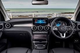 It's swathed in trim that flows down from the center display screen, in a wood or metallic waterfall. Mercedes Benz Glc Interior Cabin 2019 Autobics