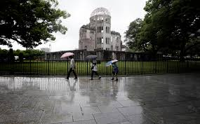 ap photos hiroshima after the atomic bomb and today wtop  a bomb hiroshima photo essay in this 4 2015 photo ors walk in the rain next to now known as atomic bomb dome in hiroshima western