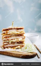 Katsu Sando japanese cutlet sandwich with deep fried  pork,cabbage,mayonnaise and tonkatsu sauce on a light background — Stock  Photo © DariaArnautova #334284996