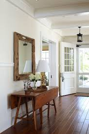 hanging heavy mirror on drywall traditional entry also beadboard ceiling chair rail drop leaf table entry