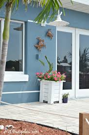 how to hang outdoor wall decor without