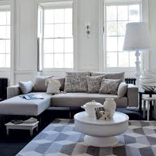Monochromatic Living Room Decor Unique White Round Coffee Table And Monochromatic Diamon Printed