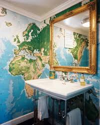 cool bathroom with ornate framed mirror and map wallpaper