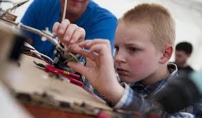 kid with electronics photo
