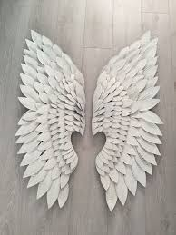 pair of extra large white metal angel wings wall art