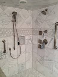 white bathroom with marble tile traditional bathroom