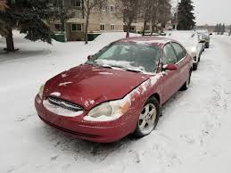 Image result for image of red ford taurus covered in snow