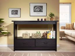 Butter Yellow Wall Color With Nice Black Console Table With Storage