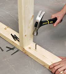 how to fasten an interior wall to concrete better homes