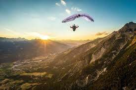 tristan shu photography high up in the air the alps a sunset and a full stall glider with jean baptiste chandelier