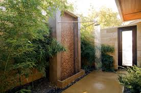 outdoor bathroom design with bamboo plants also freestanding shower wall  and concrete fence