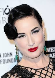 dita von teese finished off her eye catching beauty look with a glossy red lip