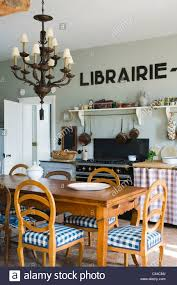 Eclectic Kitchen Eclectic Kitchen With Wooden Dining Table Lamp Chandelier And Art