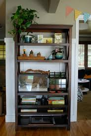 i wanted solid wood in a dark finish and this bookshelf meets both requirements cons the shelves are wood