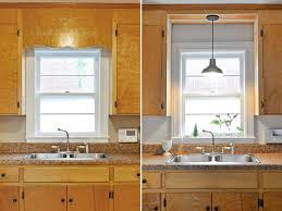 remove decorative wood over kitchen sink and install pendant with light remodel 0