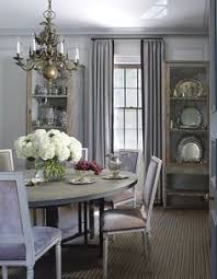 the backs of the dining room chairs in this sag harbor home are upholstered in de