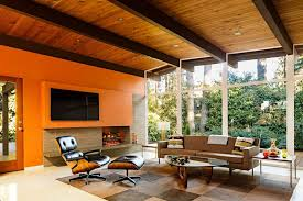 mid century modern fireplace living room midcentury with natural lighting waterfall countertop wood ceiling beams