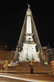 tree lighting indianapolis. every christmas season the monument is decorated as an enormous tree this city tradition known circle of lights lighting indianapolis