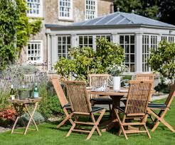 teak garden table and folding chairs daisy pedestal and snapdragons
