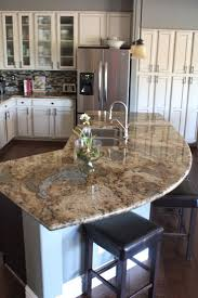 My kitchen with antiqued finished, cream cabinets and espresso island.  #island #granite