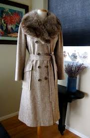 note the classic 1930 s influence on this 1967 tweed midi length winter coat with its face flattering natural coyote fur portrait collar