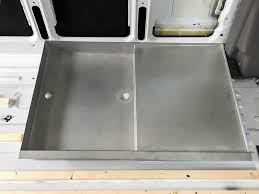 if we had a ground level shower tray the cassette would be at one level with the lower bar and then could not be taken out