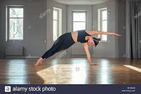 Light Pilates Yoga Studio Morning Yoga Girl Doing Stretching Exercises In The Room For