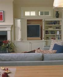 Comfy Grey Living Room Sofa Face To The White Tv Armoire Paired ...