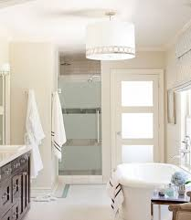 pristine white bath with gorgeous framed glass shower door