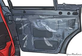 inside of car door panel with plastic sheeting in place