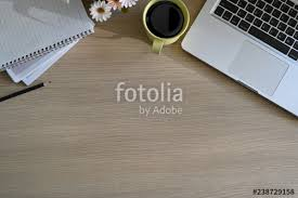 Top office table cup Notepad Computer Top Office Wood Table With Cup Of Coffee Notebook Pencil Laptop And Copy Space Fotoliacom Top Office Wood Table With Cup Of Coffee Notebook Pencil Laptop