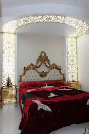 Bedrooms:Classic Luxury Bedroom With Red Bed And Classic Gold Headboard And  Golden Nightstands Classic