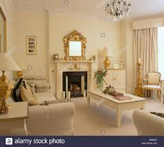 Cream Living Room With Cream Table And Sofas And Gold Accessories - Livingroom accessories