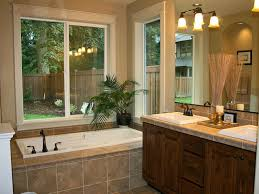 luxury bath on a budget. master bath remodel with bathtubs plus wooden vanity units double sinks and decorative vase luxury on a budget d