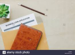 top view business office desk background the business loan appcation form pencil letter and diary