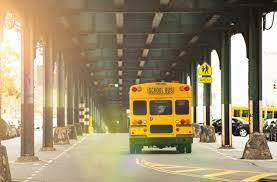 a bus is ping under the railway bridge in the bronx new york city