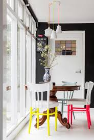 signature designs furniture worthy antique color. Round Antique Dining Table With Neon Colored Chairs Signature Designs Furniture Worthy Color R