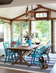 cal kitchen dining room with wood trestle table and mismatched painted chairs i like the window doors into the yard and the eat in kitchen