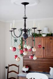 take champagne and red ornaments and hang them on green twine