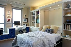 Office murphy bed Modern Home Office With Murphy Bed Lovely Lighting Adds To The Ambiance Of The Home Office And Guestroom Home Office Murphy Bed Showplace Cabinetry Home Office With Murphy Bed Lovely Lighting Adds To The Ambiance Of