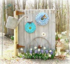 this old bottom half of a barn door was repurposed and made into adorable garden decor