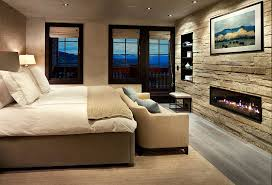 stone accent wall brings textured elegance to the modern bedroom design lisa kanning interior