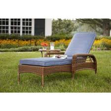 spring haven brown all weather wicker outdoor patio chaise lounge with sky blue cushions