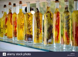 Olive Oil Decorative Bottles Decorative bottles of olive oil on a glass shelf Stock Photo 2