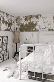 Lovely white/neutral bedroom with old wrought iron bed.