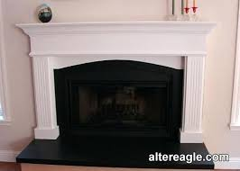 mantel surround with an arch custom fireplace mantels calgary